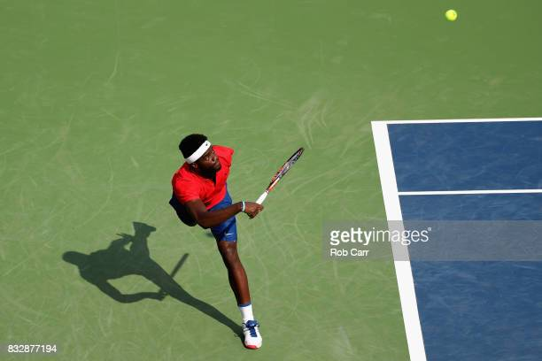 Frances Tiafoe returns a shot to Alexander Zverev of Germany during Day 5 of the Western Southern Open at the Linder Family Tennis Center on August...