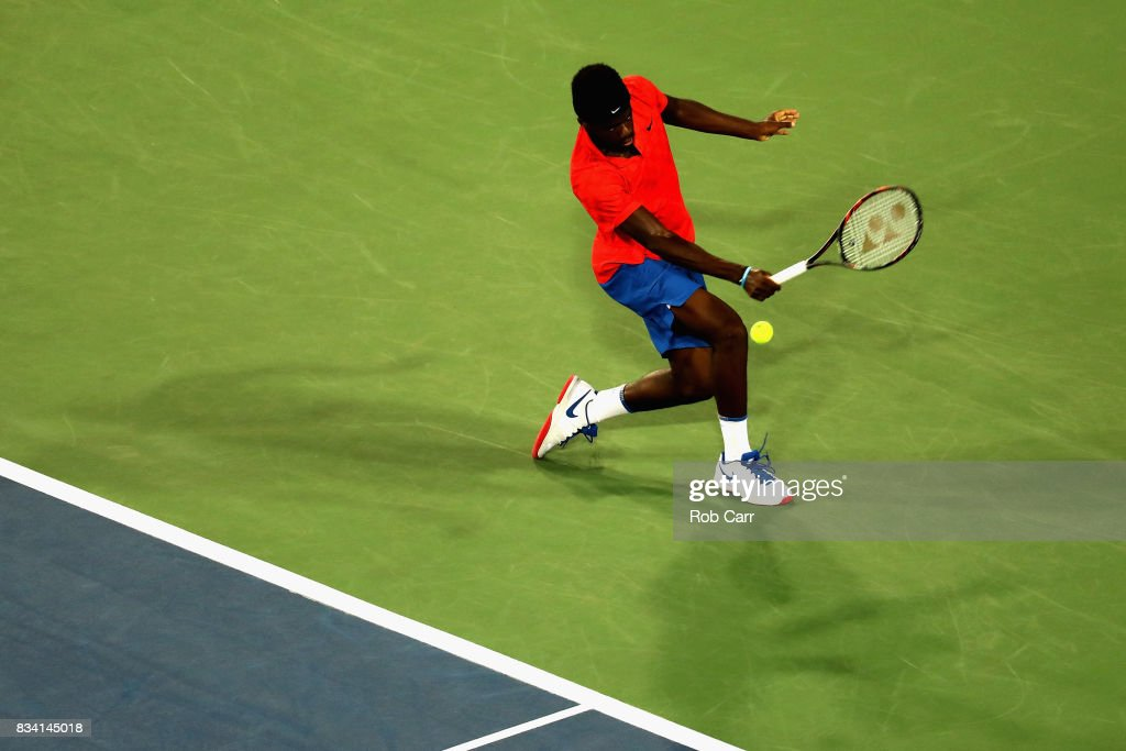 Frances Tiafoe returns a shot to John Isner during Day 6 of the Western and Southern Open at the Linder Family Tennis Center on August 17, 2017 in Mason, Ohio.