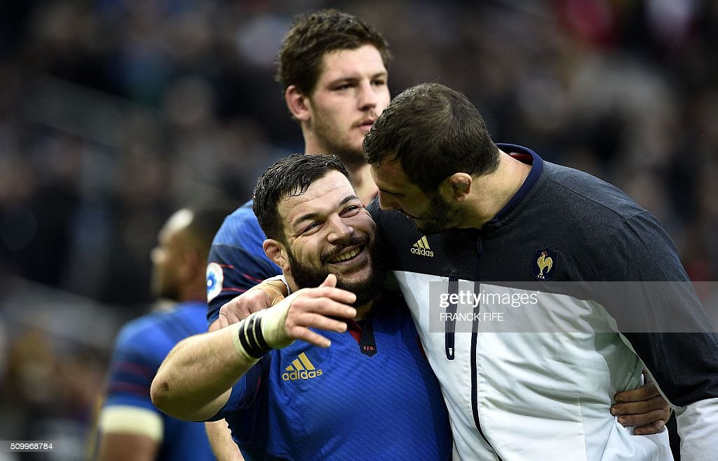 Frances tight head prop Rabah Slimani (L) and Frances lock Yoann Maestri celebrate after France defeated Ireland 10-9 in their Six Nations international rugby union match on February 13, 2016 at the Stade de France in Saint-Denis, north of Paris. AFP PHOTO / FRANCK FIFE / AFP / FRANCK FIFE