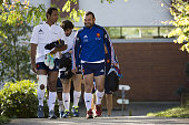 France's tighthead prop Nicolas Mas and backrow Thierry Dusautoir attend a training session in Marcoussis south of Paris on October 29 2013 ahead of...