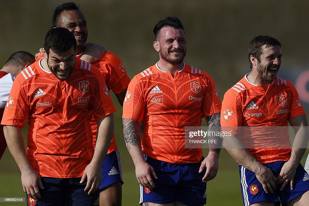 France's tighthead prop Rabah Slimani, France's lock Jocelino Suta, France's prop Thomas Domingo and France's winger Marc Andreu joke during a training session in Marcoussis, south of Paris, on March 17, 2015 ahead of the Six Nations rugby union match between France and England.
