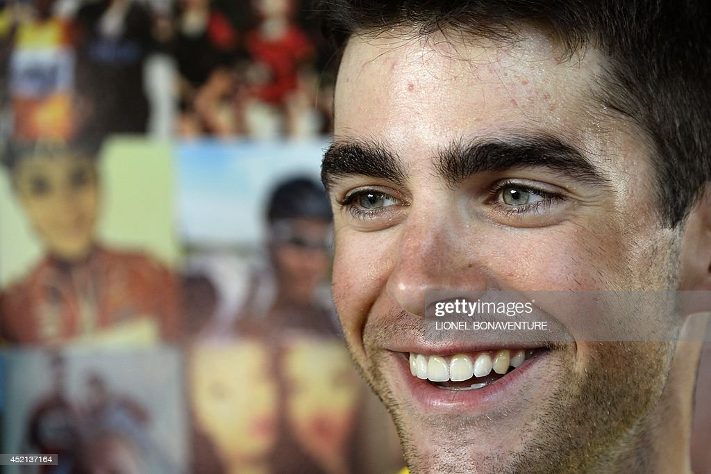 France's <a gi-track='captionPersonalityLinkClicked' href=/galleries/search?phrase=Tony+Gallopin&family=editorial&specificpeople=6712360 ng-click='$event.stopPropagation()'>Tony Gallopin</a> wearing the overall leader's yellow jersey smiles at the departure village in Mulhouse, before the start of the 161.50 km tenth stage of the 101st edition of the Tour de France cycling race on July 14, 2014 between Mulhouse and La Planche des Belles Filles ski resort, eastern France.