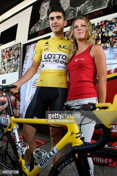 France's Tony Gallopin wearing the overall leader's yellow jersey poses with his girlfriend French cyclist Marion Rousse at the departure village in...
