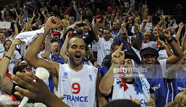 France's Tony Parker celebrates with his supporters after his team won the EuroBasket 2011 semifinal match between France and Russia in Kaunas on...