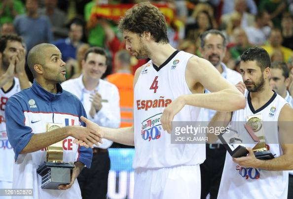 France's Tony Parker congratulates Spain's Pau Gasolduring the gold medal match between Spain and France during the EuroBasket2011 in Kaunas on 18...