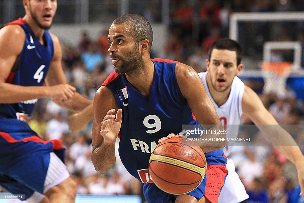 France's Tony Parker (C) dribbles during a friendly basketball match between France and Serbia on August 15, 2013 in Antibes, southeastern France as part of the preparation for the 2013 EuroBasket in Slovenia.
