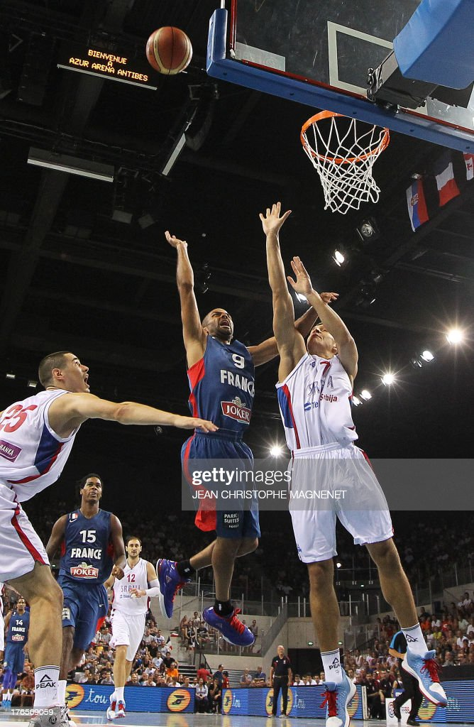 France's Tony Parker (C) is challenged by Serbia's Vladimir Lucic (R) during a friendly basketball match between France and Serbia on August 15, 2013 in Antibes, southeastern France as part of the preparation for the 2013 EuroBasket in Slovenia.