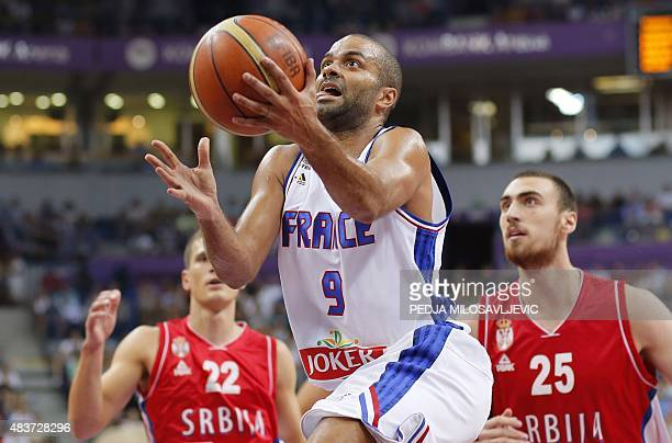 France's Tony Parker vies with Serbia's Nemanja Nedovic and Nikola Milutinov during a friendly basketball match between Serbia and France at the...