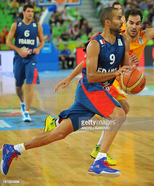 France's Tony Parker vies with Spain's Jose Calderun during their FIBA Eurobasket championships semifinal basket ball match Spain vs France at the...