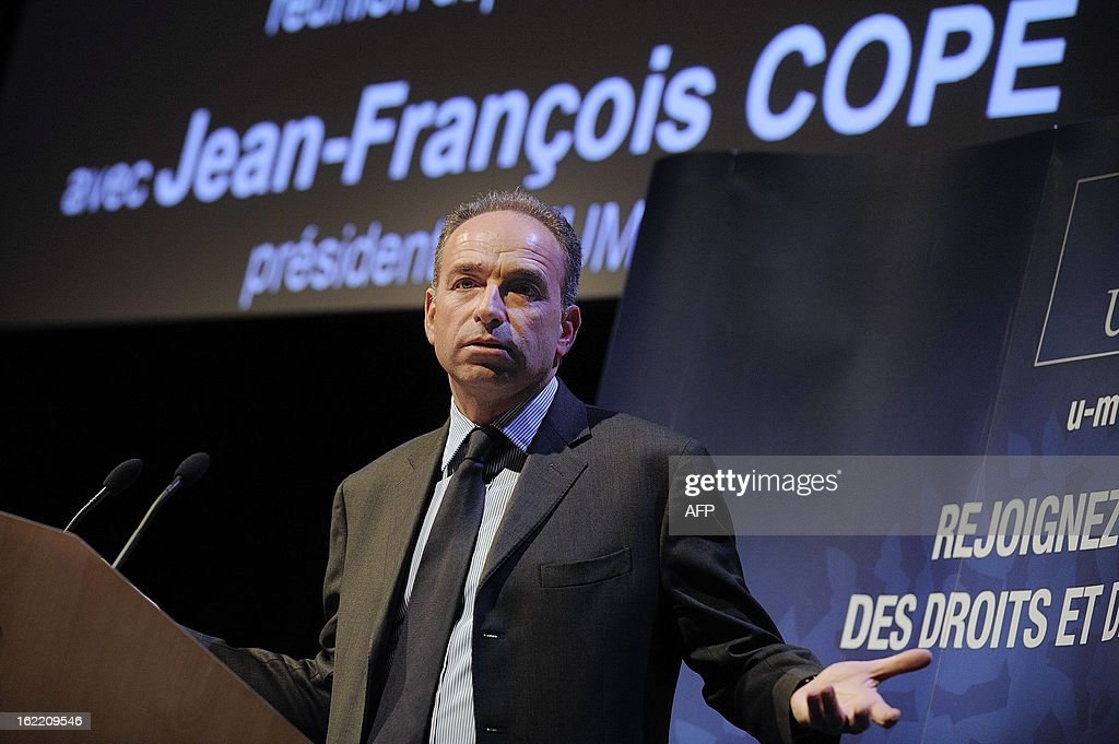 France's UMP right-wing opposition party leader Jean-Francois Cope speaks during a political meeting in Rennes, on February 20, 2013. AFP PHOTO / JEAN-SEBASTIEN EVRARD