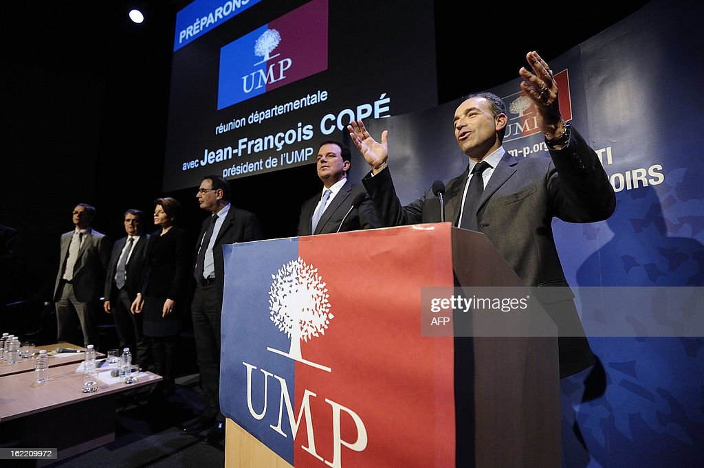 France's UMP right-wing opposition party leader Jean-Francois Cope (R) gestures during a political meeting in Rennes, on February 20, 2013.