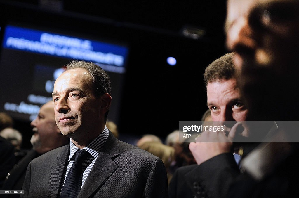 France's UMP right-wing opposition party leader Jean-Francois Cope (L) looks on during a political meeting in Rennes, on February 20, 2013.