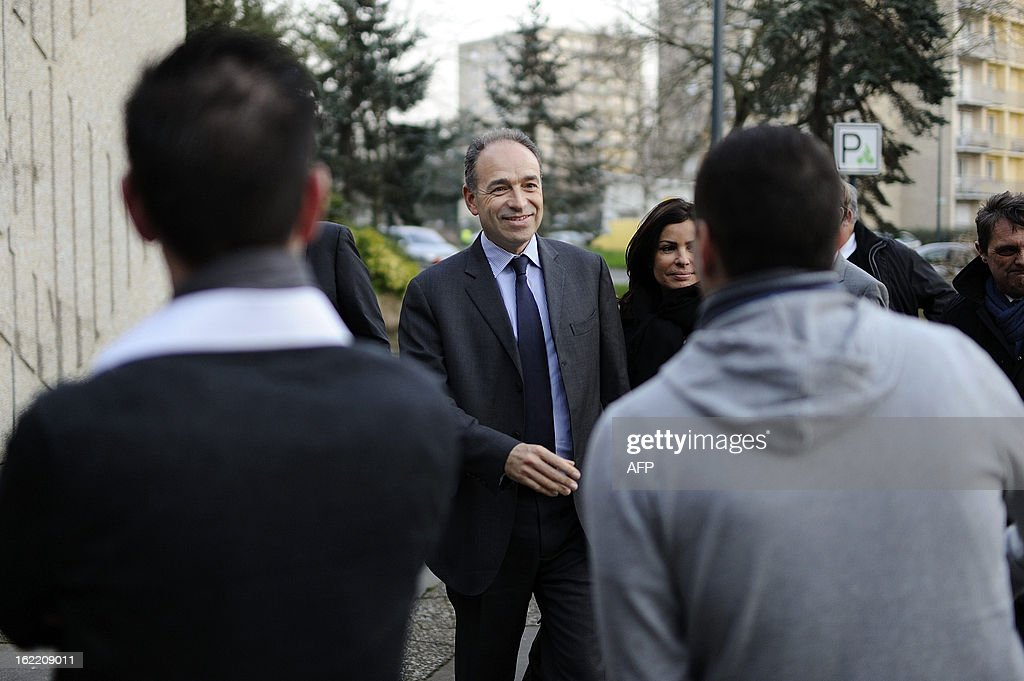 France's UMP right-wing opposition party leader Jean-Francois Cope meets with militants on February 20, 2013 before a political meeting in Rennes.