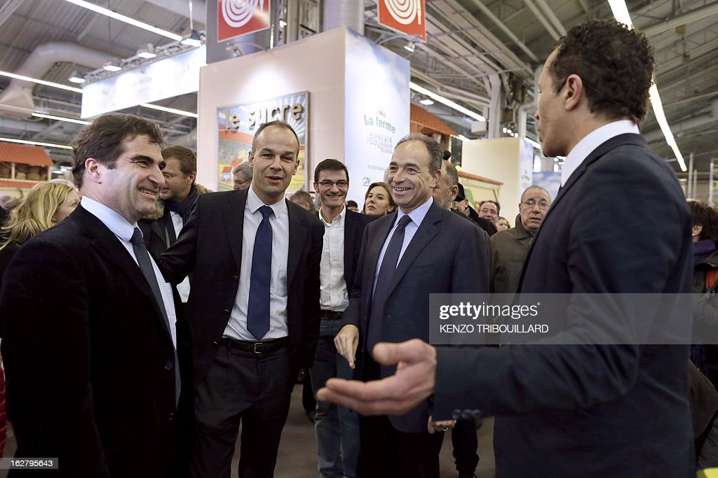 France's UMP right-wing opposition party leader Jean-Francois Cope (2ndR) talks to UMP group president at the National Assembly, Christian Jacob (L) as they visit the International Agriculture Fair of Paris at the Porte de Versailles exhibition center, on February 27, 2013. Some 1,300 exhibitors and 4,000 animals attend the fair which runs from from February 23 to March 3, 2013.