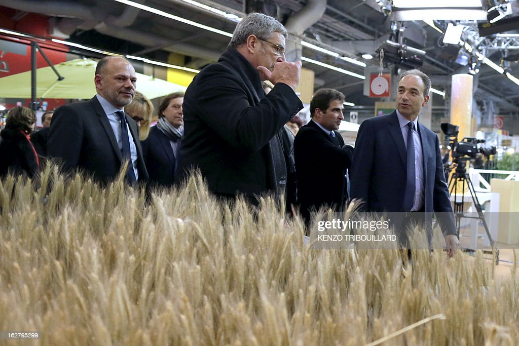 France's UMP right-wing opposition party leader Jean-Francois Cope (R) visits the International Agriculture Fair of Paris at the Porte de Versailles exhibition center, on February 27, 2013. Some 1,300 exhibitors and 4,000 animals attend the fair which runs from from February 23 to March 3, 2013.