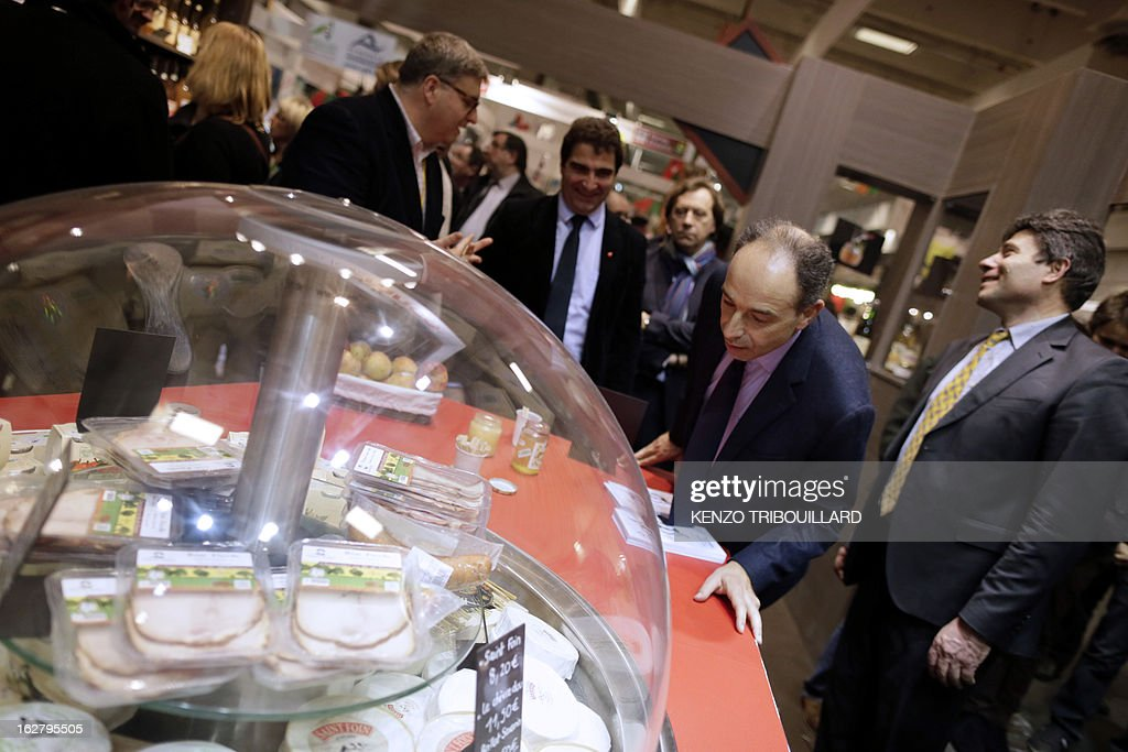 France's UMP right-wing opposition party leader Jean-Francois Cope (2ndR) visits the International Agriculture Fair of Paris at the Porte de Versailles exhibition center, on February 27, 2013. Some 1,300 exhibitors and 4,000 animals attend the fair which runs from from February 23 to March 3, 2013. AFP PHOTO KENZO TRIBOUILLARD