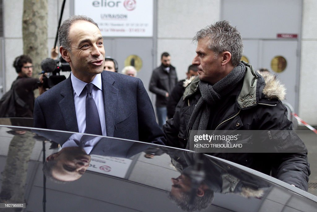 France's UMP right-wing opposition party leader Jean-Francois Cope (L) leaves the International Agriculture Fair of Paris at the Porte de Versailles exhibition center, on February 27, 2013. Some 1,300 exhibitors and 4,000 animals attend the fair which runs from from February 23 to March 3, 2013.