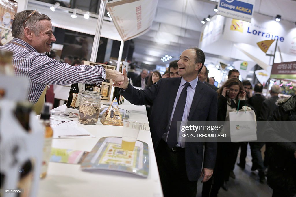France's UMP right-wing opposition party leader Jean-Francois Cope (C) visits the International Agriculture Fair of Paris at the Porte de Versailles exhibition center, on February 27, 2013. Some 1,300 exhibitors and 4,000 animals attend the fair which runs from from February 23 to March 3, 2013.