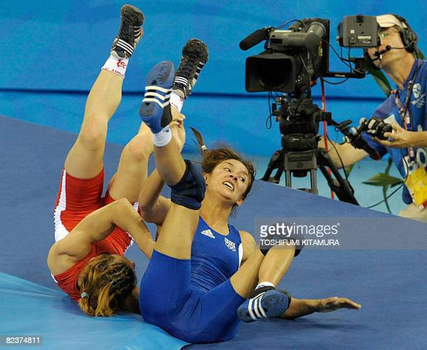 France's Vanessa Boubryemm fights with Russia's Zamira Rakhmanova in their qualification round of the women's wrestling freestyle 48kgs in the 2008...