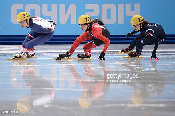 France's Veronique Pierron Canada's MarieEve Drolet and South Korea's Park SeungHi compete in the Women's Short Track 1000 m Quarterfinals at the...