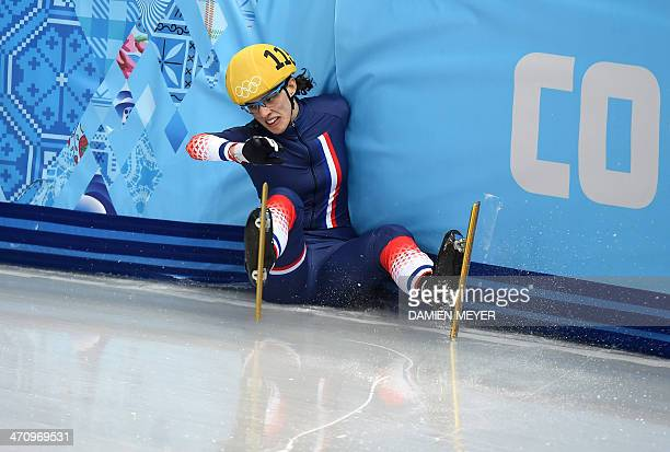 France's Veronique Pierron falls as she competes in the Women's Short Track 1000 m Quarterfinals at the Iceberg Skating Palace during the Sochi...