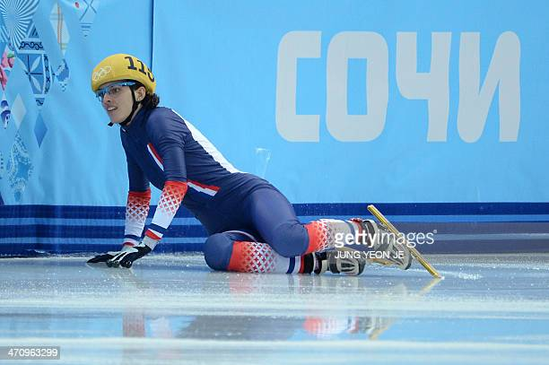 France's Veronique Pierron falls in the Women's Short Track 1000 m Quarterfinals at the Iceberg Skating Palace during the Sochi Winter Olympics on...