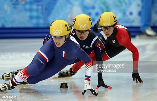France's Veronique Pierron South Korea's Park SeungHi and Canada's MarieEve Drolet compete in the Women's Short Track 1000 m Quarterfinals at the...
