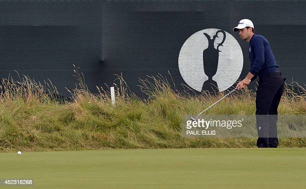 France's Victor Riu putts on the 3rd green during his second round on day two of the 2014 British Open Golf Championship at Royal Liverpool Golf...
