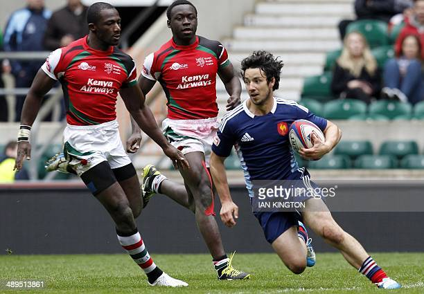 Frances Vincent Deniau runs with the ball during the Rugby Sevens Plate semi final between France and Kenya at the IRB Rugby Sevens series at...