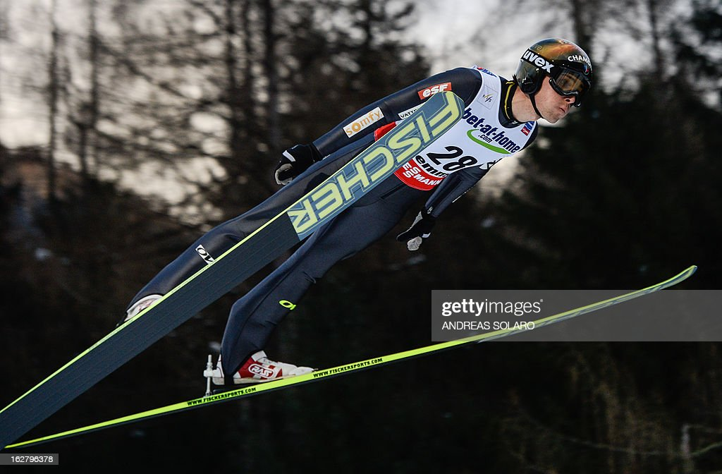 France's Vincent Sevoie Descombes soars through the air on February 27, 2013 during the Large Hill Individual qualification race of the FIS Nordic World Ski Championships at the Ski Jumping stadium in Predazzo, northern Italy. AFP PHOTO / ANDREAS SOLARO
