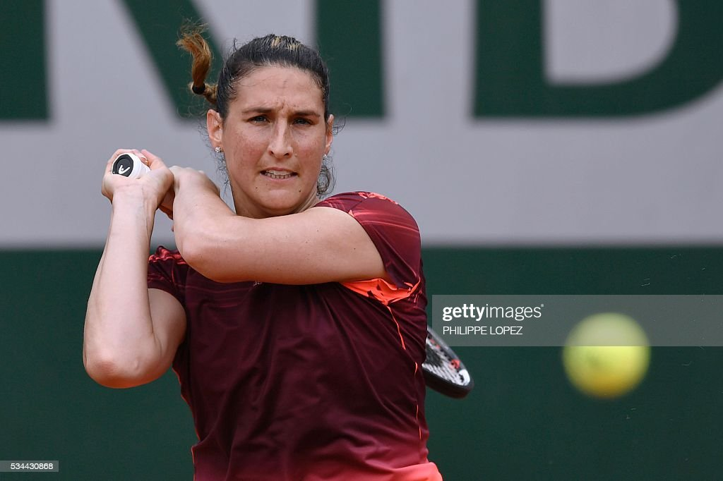France's Virginie Razzano returns the ball to Russia's Darya Kasatkina during their women's second round match at the Roland Garros 2016 French Tennis Open in Paris on May 26, 2016. / AFP / PHILIPPE