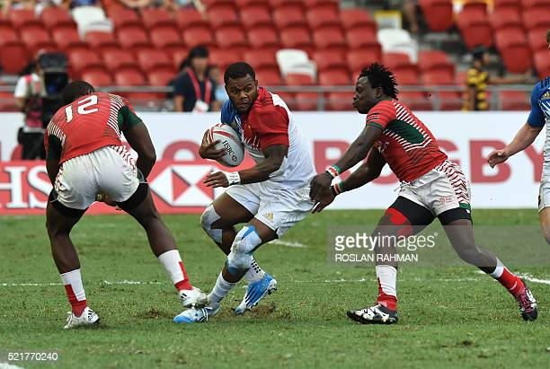 France's Virimi Vakatawa runs with the ball during their cup quarterfinal match against Kenya at the Singapore Sevens rugby tournament on April 17...