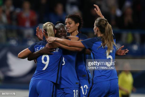 France's Viviane Asseyi celebrates after scoring during a friendly football match between France and Chile at Michel D'Ornano Stadium in Caen on...