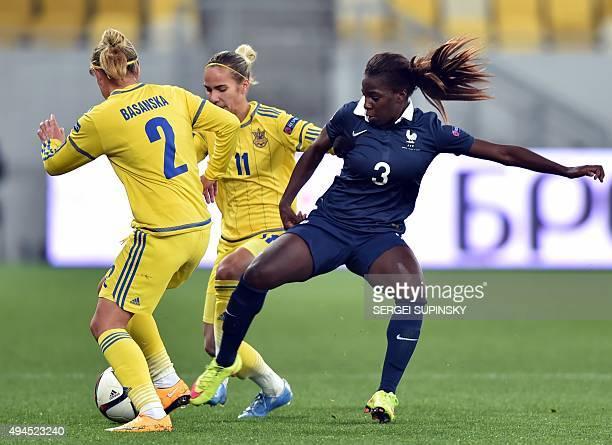 France's Viviane Asseyi vies with Ukraine's Tetyana Chorna and Ukraine's Tetyana Romanenko during the Women's EURO 2017 Group 3 qualifying football...