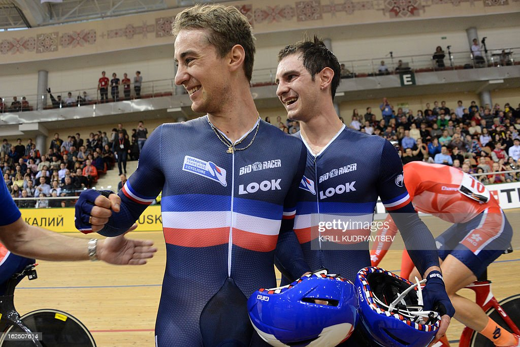 France's Vivien Brisse (L) and Morgan Kneisky celebrate their gold medal after the UCI Track Cycling World Championships Men's 50 km Madison in Belarus' capital of Minsk on February 24, 2013.