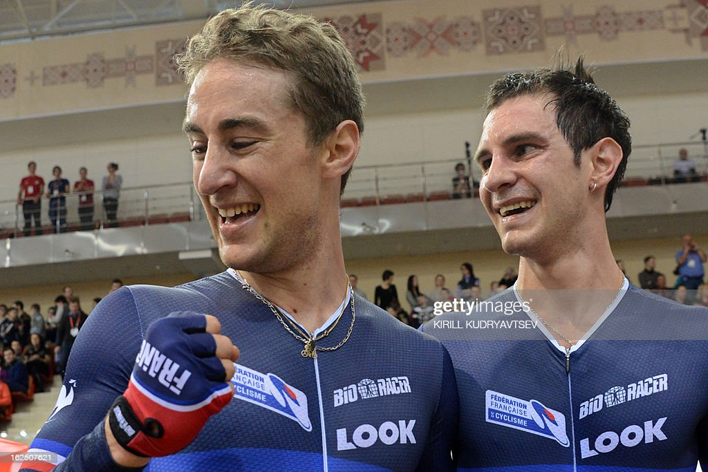 France's Vivien Brisse (L) and Morgan Kneisky celebrate their gold medal after the UCI Track Cycling World Championships Men's 50 km Madison in Belarus' capital of Minsk on February 24, 2013. AFP PHOTO/KIRILL KUDRYAVTSEV