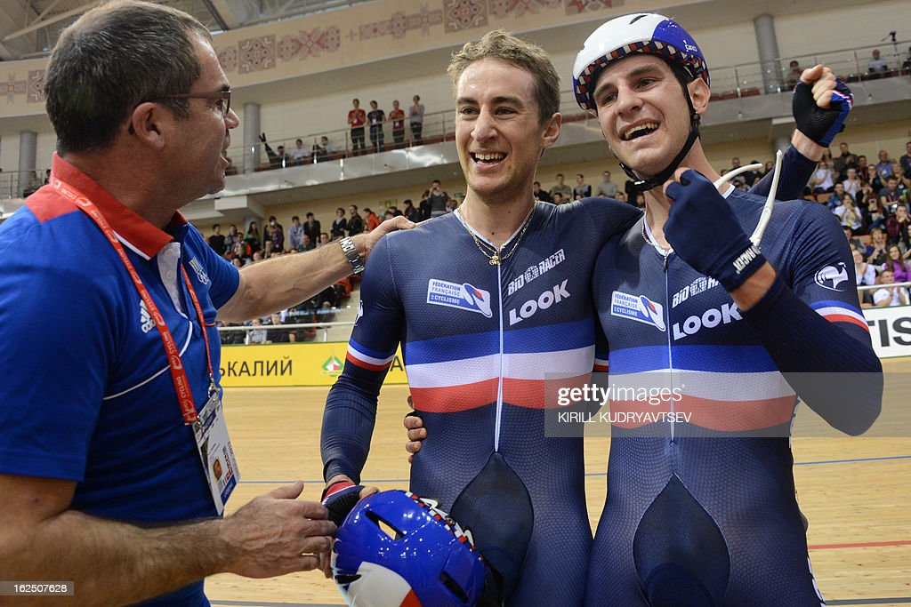 France's Vivien Brisse (C) and Morgan Kneisky (R) celebrate their gold medal after the UCI Track Cycling World Championships Men's 50 km Madison in Belarus' capital of Minsk on February 24, 2013.