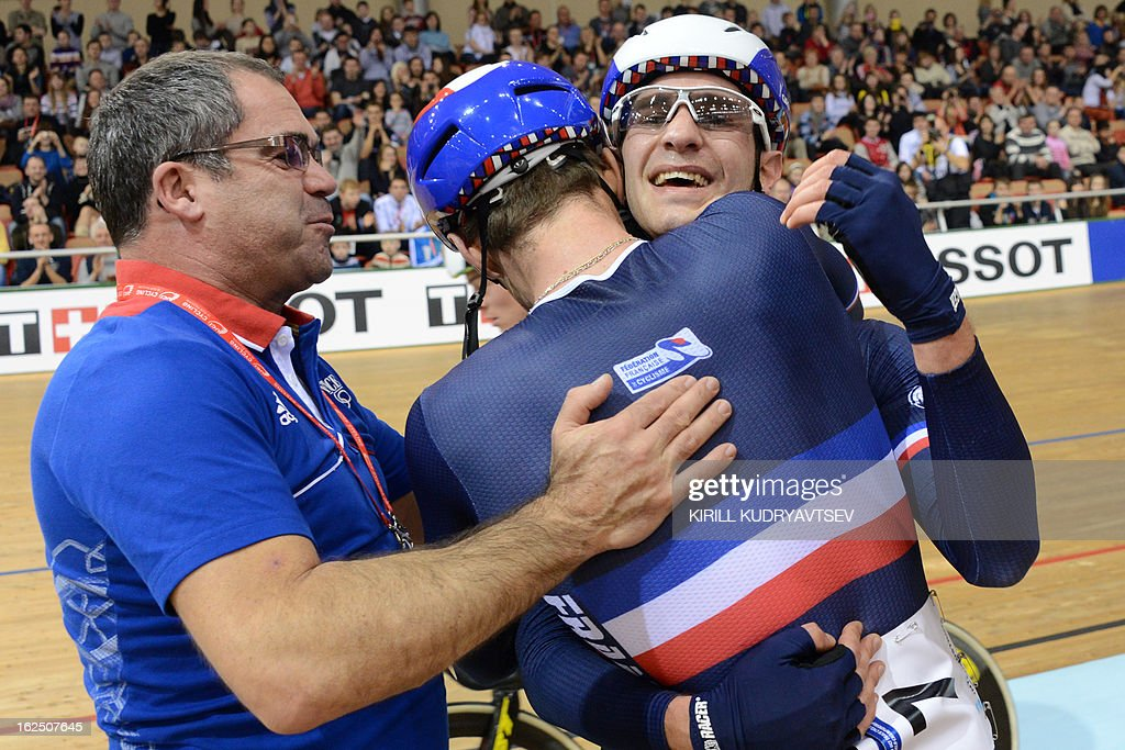 France's Vivien Brisse and Morgan Kneisky (R) celebrate with their coach (L) the gold medal in UCI Track Cycling World Championships Men's 50 km Madison in Belarus' capital of Minsk on February 24, 2013.