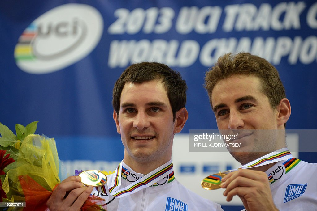 France's Vivien Brisse (R) and Morgan Kneisky celebrate with their gold medal of the UCI Track Cycling World Championships Men's 50 km Madison in Belarus' capital of Minsk on February 24, 2013.