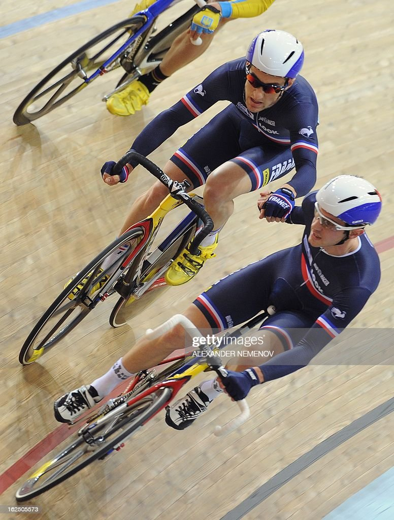 France's Vivien Brisse (R) and Morgan Kneisky relay on their way to win the gold medal of the Men's 50km Madison event of the UCI Track Cycling World Championships in Minsk on February 24, 2013.