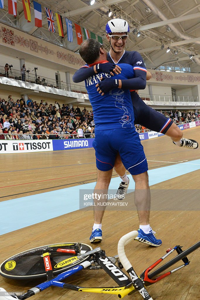 France's Vivien Brisse team celebrates with his coach France's team gold medal in UCI Track Cycling World Championships Men's 50 km Madison in Belarus' capital of Minsk on February 24, 2013. AFP PHOTO/KIRILL KUDRYAVTSEV
