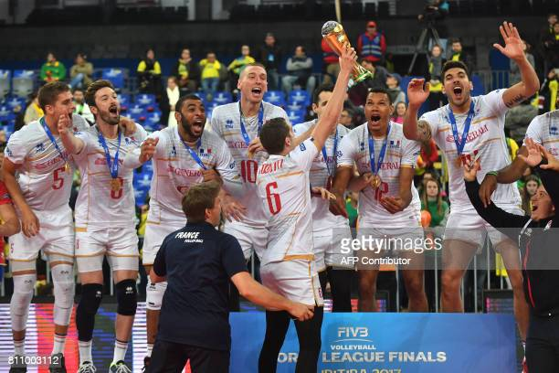 CORRECTION France's volleyball team players celebrate with the trophy their first place finish in the World League 2017 in Curitiba Brazil on July 09...
