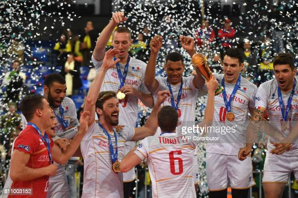 TOPSHOT CORRECTION France's volleyball team players celebrate with the trophy their first place finish in the World League 2017 in Curitiba Brazil on...