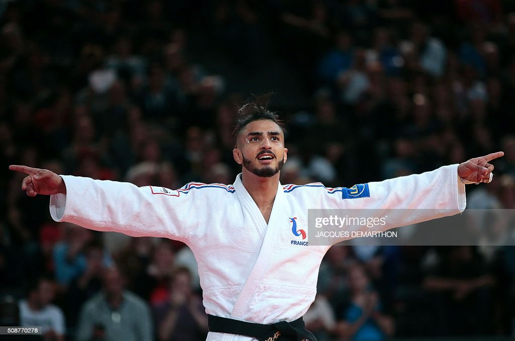 France's Walide Khyar celebrates beating Uzbekistan's Sharafuddin Lutfillaev in the men's under 60 kg bronze medal match of the Paris Grand Slam Judo tournament on February 6, 2016 in Paris. / AFP / JACQUES DEMARTHON