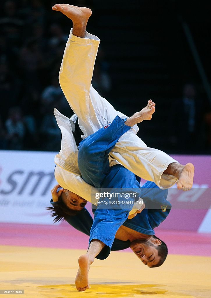 France's Walide Khyar (L) competes and wins against Uzbekistan's Sharafuddin Lutfillaev in the men's under 60 kg bronze medal match of the Paris Grand Slam Judo tournament on February 6, 2016 in Paris. / AFP / JACQUES DEMARTHON