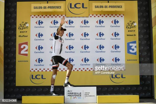 France's Warren Barguil arrives on the podium to celebrate his polka dot jersey of best climber at the end of the 2225 km nineteenth stage of the...