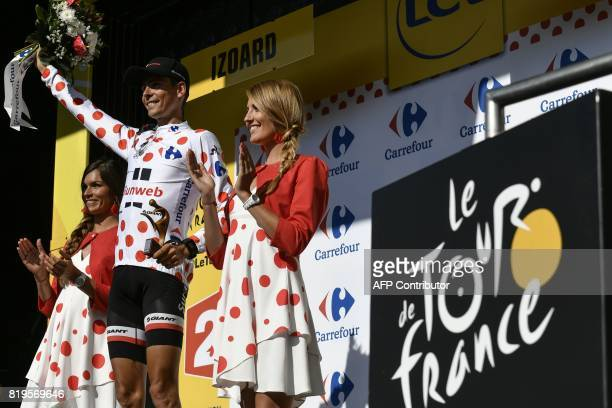France's Warren Barguil celebrates his polka dot jersey of best climber on the podium at the end of the 1795 km eighteenth stage of the 104th edition...