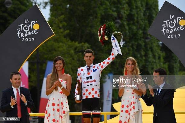 France's Warren Barguil celebrates his polka dot jersey of best climber on the podium at the end of the 103 km twentyfirst and last stage of the...