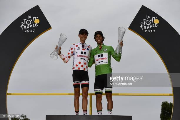 France's Warren Barguil wearing the best climber's polka dot jersey and his teammates Australia's Michael Matthews wearing the best sprinter's green...