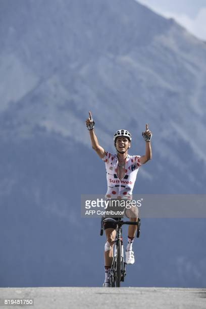 France's Warren Barguil wearing the best climber's polka dot jersey celebrates as he crosses the finish line at the end of the 1795 km eighteenth...